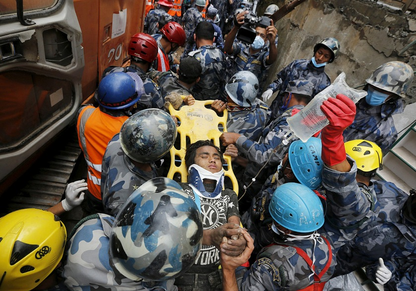 "ATTENTION EDITORS - REUTERS PICTURE HIGHLIGHT Earthquake survivor Pema Lama, 15, is rescued by the Armed Police Force from the collapsed Hilton Hotel, the result of an earthquake in Kathmandu, Nepal April 30, 2015. REUTERS/Adnan Abidi      TPX IMAGES OF THE DAY REUTERS NEWS PICTURES HAS NOW MADE IT EASIER TO FIND THE BEST PHOTOS FROM THE MOST IMPORTANT STORIES AND TOP STANDALONES EACH DAY. Search for ""TPX"" in the IPTC Supplemental Category field or ""IMAGES OF THE DAY"" in the Caption field and you will find a selection of 80-100 of our daily Top Pictures. REUTERS NEWS PICTURES.  TEMPLATE OUT"