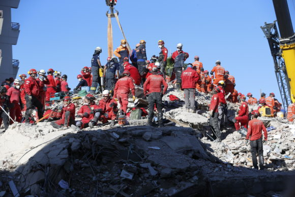 Members of rescue services search in the debris of a collapsed building for survivors in Izmir, Turkey, early Sunday, Nov. 1, 2020. Rescue teams continue ploughing through concrete blocs and debris of collapsed buildings in Turkey's third largest city in search of survivors of a powerful earthquake that struck Turkey's Aegean coast and north of the Greek island of Samos, Friday Oct. 30, killing dozens Hundreds of others were injured.(AP Photo/Darko Bandic)